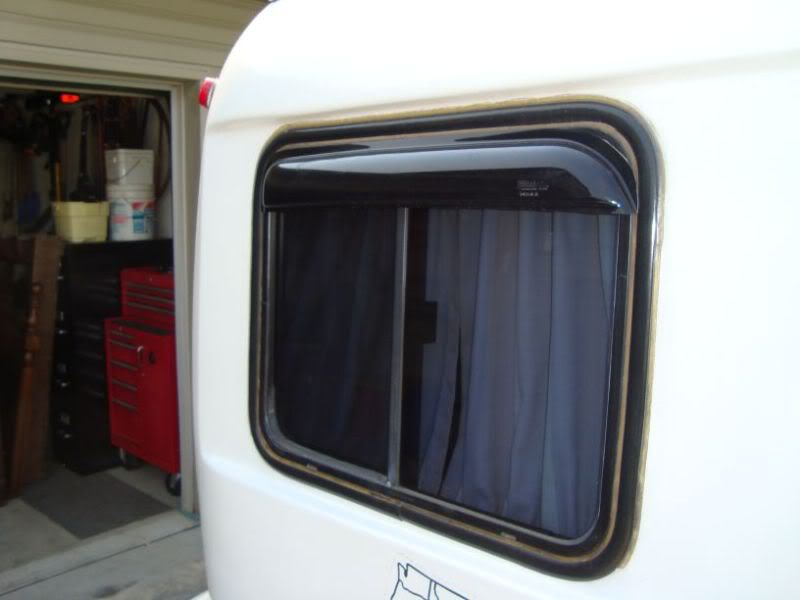 Put some rain guards over the side windows - Fiberglass RV
