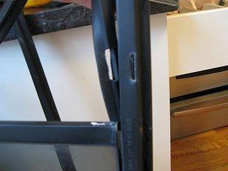 cutting holes in felt to match gutter.jpg