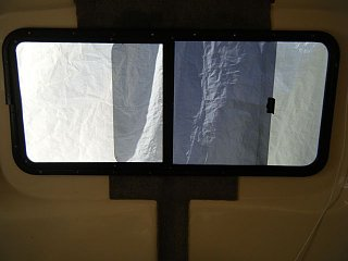 back window, metal clamp.jpg