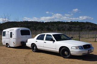 Retired cop car & 13' Casita.jpg