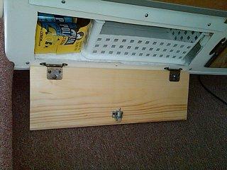 Under fridge soda and can storage.jpg