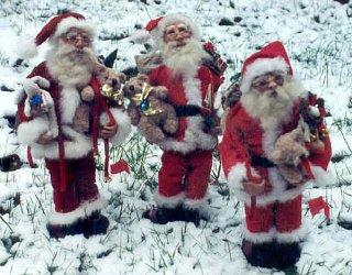 three santas in snow.jpg