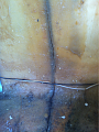 cracked seam area beneath front carpet area. just under bunk area.. another area to fix with fiberglass.