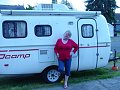 Catherine in front of her 2009 16' Scamp trailer...summer 2011.