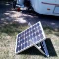 Solar panel all hooked up and taking in the rays.  Made a stand for it out of aluminum angle.  Got the idea from somewhere on Fiberglass RV forum.